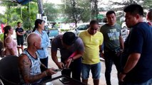 Motorcyclist snatches tourist's bag when he drinks coffee in Thailand