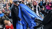 Extinction Rebellion protesters clash with police as tents get dismantled at London's Trafalgar Square
