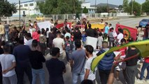 Syrian Kurds protest Turkish offensive outside refugee camp in Greece