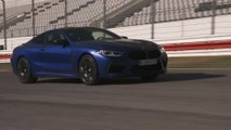 The new BMW M8 Coupé Driving on the Racetrack