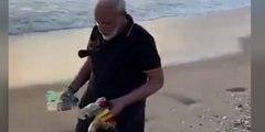 Así recoge basura en la playa el primer ministro indio Modi antes de reunirse con líder chino Xi