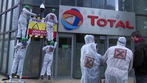 Activists spray paint Paris building of energy firm Total
