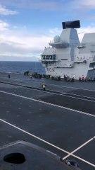 Merlin helicopters land on HMS Queen Elizabeth