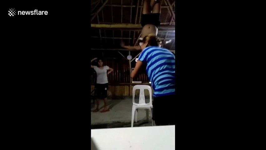 Hilarious moment dancer swings from roof and then falls on his back