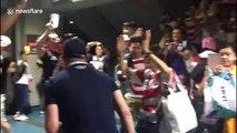 Fans celebrate Japan's historic victory over Scotland at Yokohama stadium