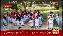 Students taking classes outside the school in extreme hot weather