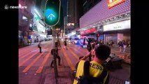 Hong Kong riot police clear barricade as tensions remain high in another weekend of protests