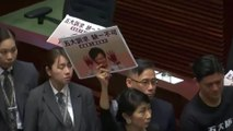 Heckling forces Lam to cancel HK policy speech