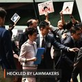Hong Kong leader abandons policy speech after heckles from lawmakers