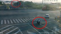 Chinese biker luckily avoids being crushed by truck after running red light
