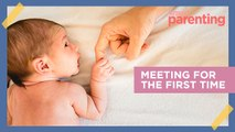 7 Photos of Dads Meeting Their Babies for the First Time