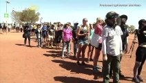 Climbers Form Long Lines On Australia's Uluru Before Climbing Ban Takes Effect!
