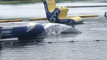Woman Trying to Launch Kid on Water Trampoline Falls Into Water