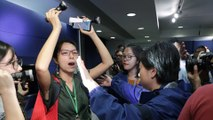 Journalist protests at Hong Kong police press conference over force's treatment of colleagues