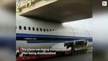 A hauler releases a plane trapped under a bridge in Harbin, China