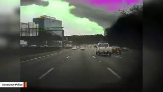 Scary Video Shows Tree Crashing On To Highway