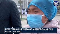 China: Nurse treating Coronavirus patients gives emotional air hug to daughter|OneIndia