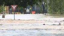 Bushfires, cyclone, torrential rain hit Australia's coasts