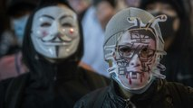 Hong Kong Protestors Torch Chinese State Media Offices