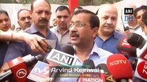 Delhi CM Kejriwal distributes masks to school children