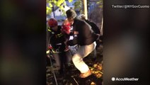 New York Governor Andrew Cuomo assists EMS crew during water rescues