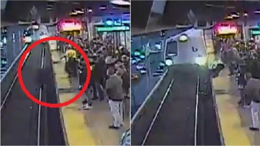 Watch terrifying video: Man falls on tracks in front of train, worker saves him