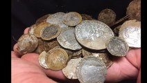 Metal detectorist find hoard of coins thought to be worth £100,000 in a field in Northern Ireland