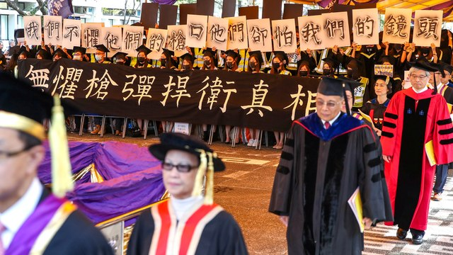 Graduation ceremony halted after masked university students rally at the event in Hong Kong