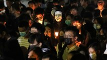 Thousands hold vigils for Hong Kong student who died after car park fall