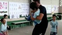 Teacher Brightens Student's Day By Helping Him Jump Rope