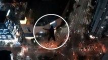 해운대 고층 건물에서 낙하산 활강 외국인들 체포 / YTN