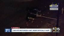 Car hits motorized cart, driver critically hurt