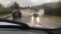 UK man drives through flooded road on his way to work