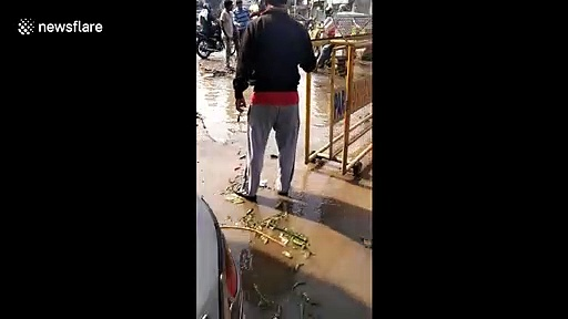 Motorcycle fished out of giant flooded pothole on north Indian road