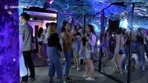 Visitors enjoy colourful interactive light show in Bangkok