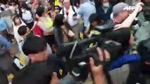 Pro-Beijing lawmaker heckled by crowd in Hong Kong