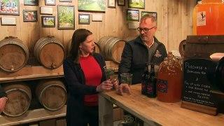 Jo Swinson swigs cider in Cheltenham