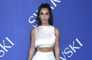 Kim Kardashian West won't talk about her body woes in front of her kids