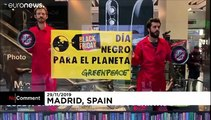 Black Friday protesters picket Amazon as Greenpeace demonstrate in Madrid