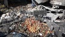 Aftermath of Syria regime strike on Idlib market