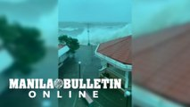 Storm surge slamming into the breakwater barrier in Mauban, Quezon