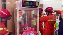 Chinese firefighters free boy trapped inside claw machine after he climbed inside for toys