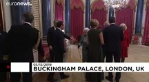 Queen Elizabeth hosts NATO leaders at Buckingham Palace as protesters gather outside