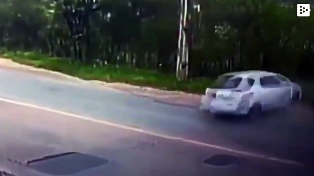A car in Brazil crashes into a pole and breaks in two