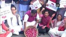 P Chidambaram, Congress leaders protest against onion price hike at Parliament