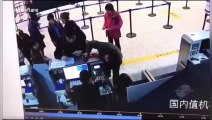 Chinese man violently rips off airport worker's employee card after arguing with her