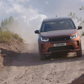 New Land Rover Discovery Sport in Namib Orange Off-Road Driving