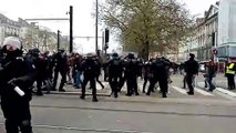Policeman throws woman to the ground as protests against retirement reform paralyse France