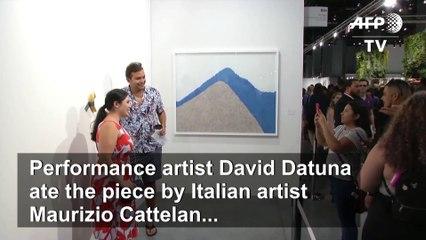 Man eats $120,000 piece of art - a banana taped to a wall