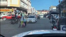 Kindhearted driver hold up traffic to help old lady cross the road